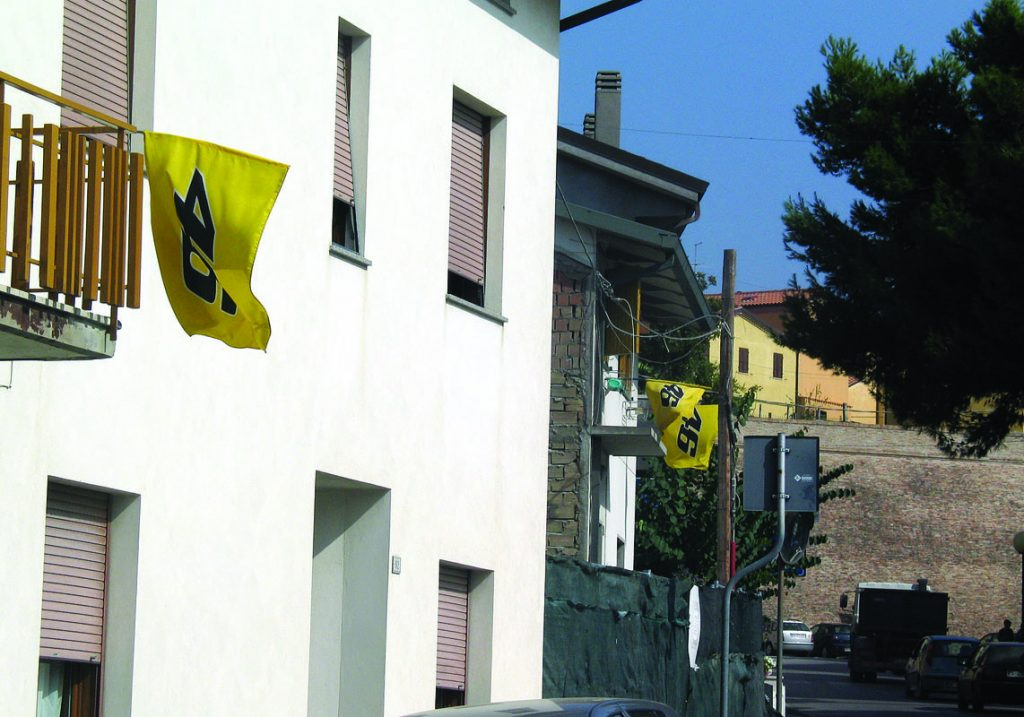 Yellow VR46 flags line the streets of Tavullia, while every car seems to have a Rossi bumper sticker...