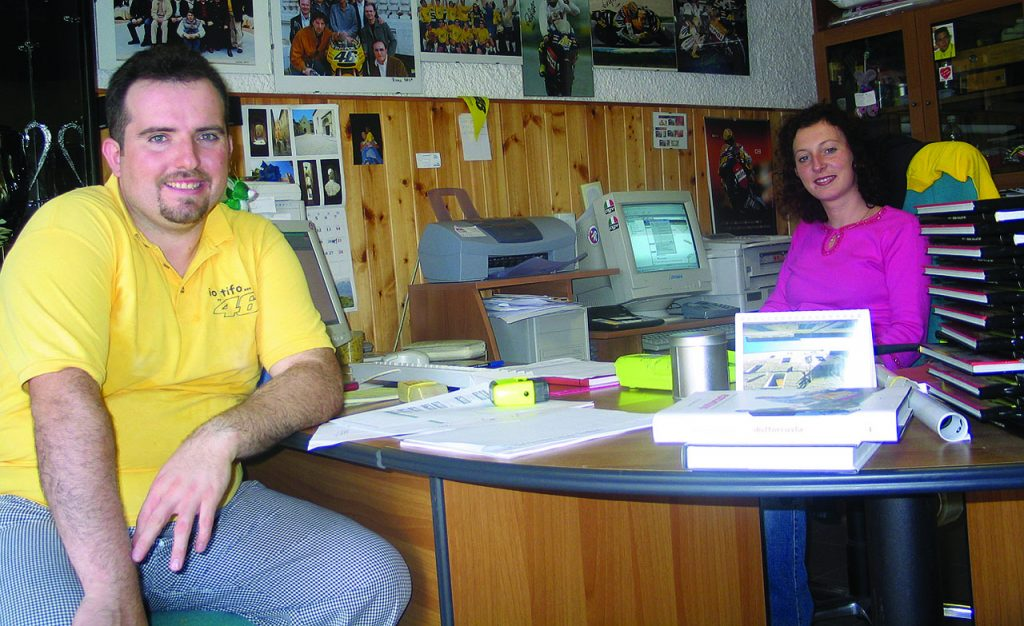 Paride introduces us to Ms Buscaglia, the fan club secretary. She smiles as Paride explains to her that we are from Australia and then, in broken English, she offers Heather a Valentino Rossi biography as a gift...